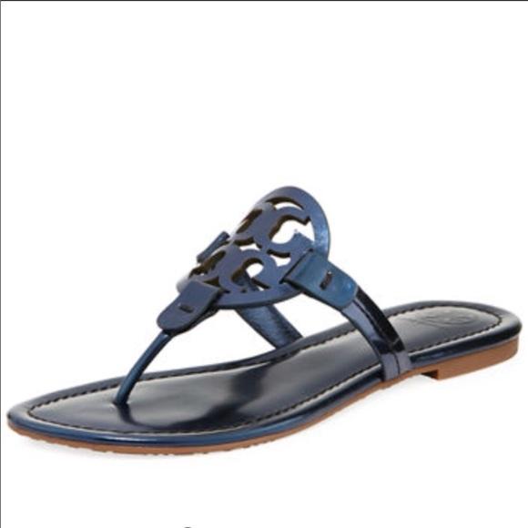 1c3c15085 Tory Burch Miller Metallic Flat Slide Sandal. M 5a9a58873b160882574f0a8f